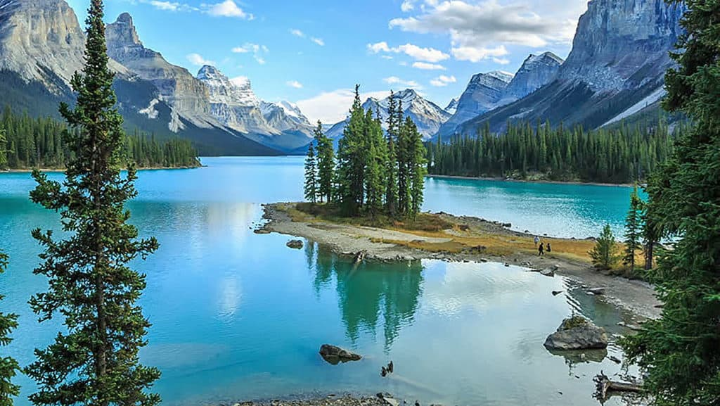 SUP stand up paddle boarding in Maligne Lake Alberta Canada